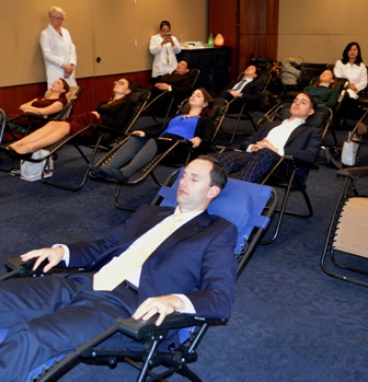 Capitol Hill Staff experience acupuncture during briefing.