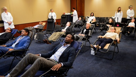 Congressional staff enjoy a session of acupuncture during briefing.
