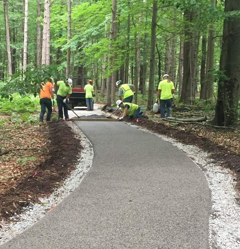 Minimally Intrusive Installation of Porous Pave Protects the Trees